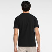 Model facing back wearing a black, short sleeve, tee shirt.