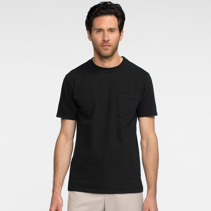 Model facing forward wearing a black, short sleeve, pocket tee shirt.