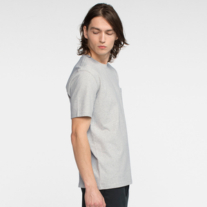 Model side facing wearing a heather grey, short sleeve, pocket tee shirt.