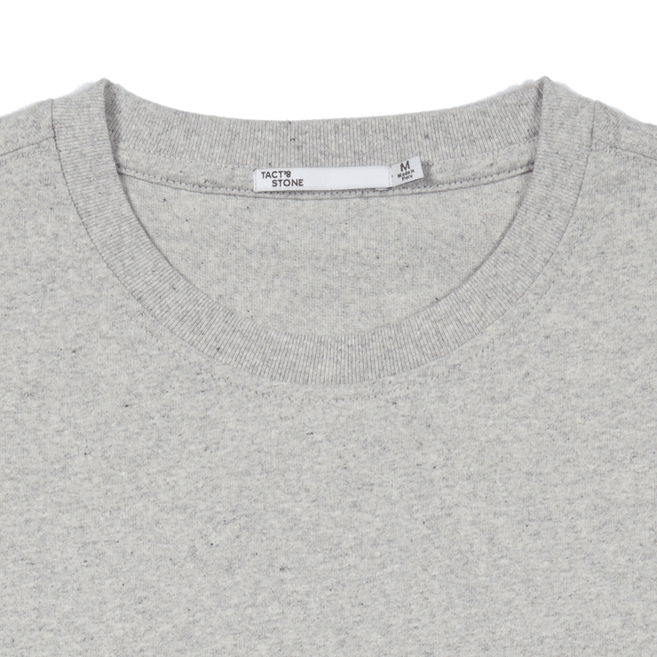 Flat lay focused on the collar of a heather grey tee shirt.