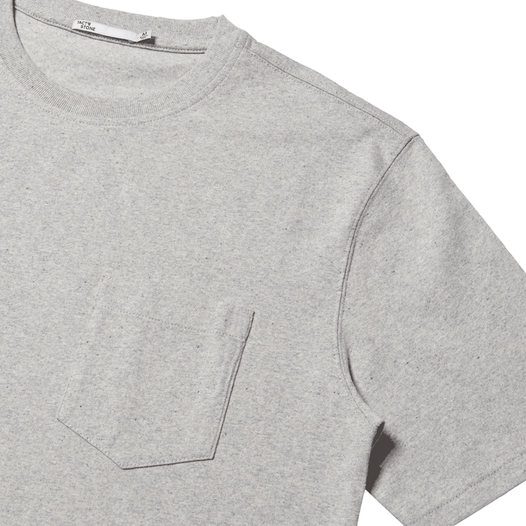 flat lay focused on the front left chest pocket of a heather grey tee shirt.