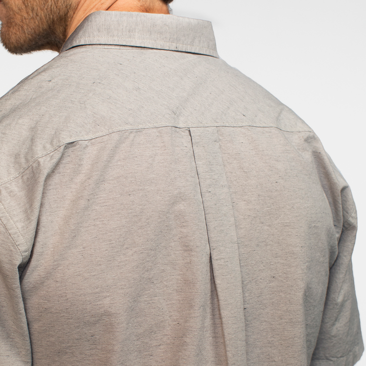 Back view of a heather grey collared shirt on a model.