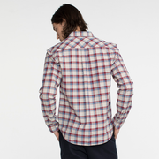 Model facing back wearing a long sleeve, plaid, button up shirt.