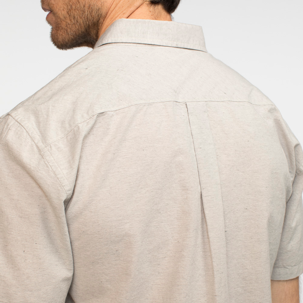 Model facing back, wearing a heather grey collared shirt. Focused on the top half of the shirt.