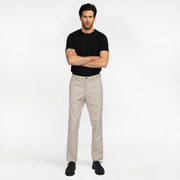 Model front facing highlighting khaki colored chinos. Sustainable, performance chinos.