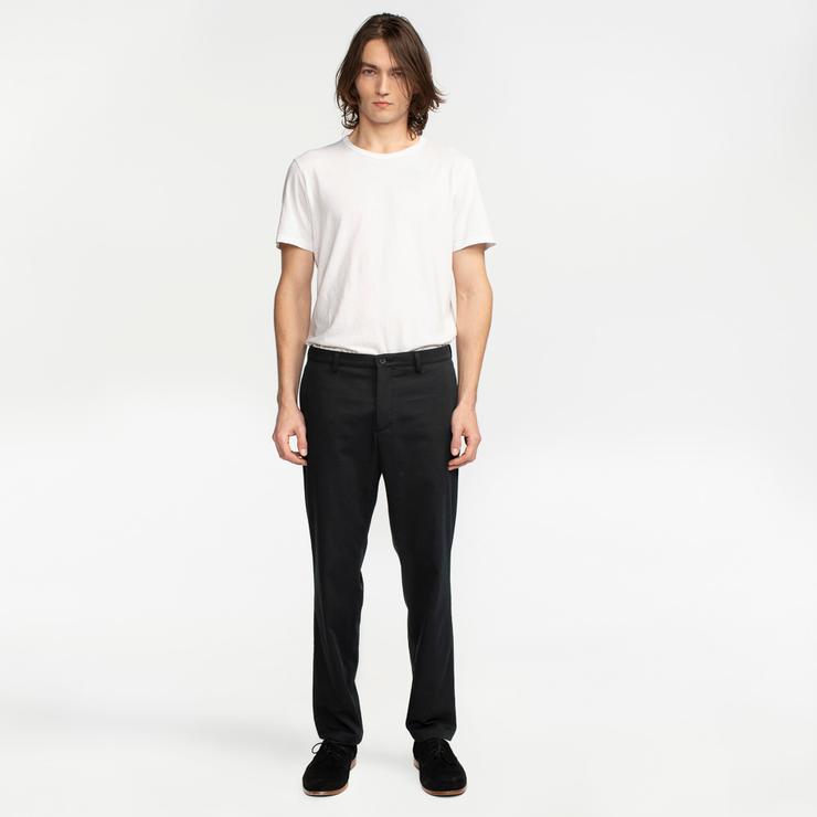 Model front facing highlighting black colored chinos. Sustainable, performance chinos.