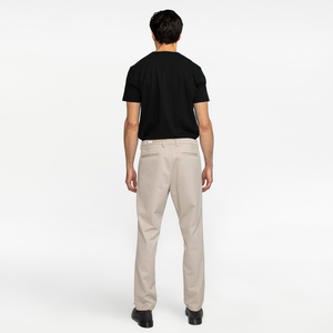 Model back view highlighting performance, sustainable khaki chinos.