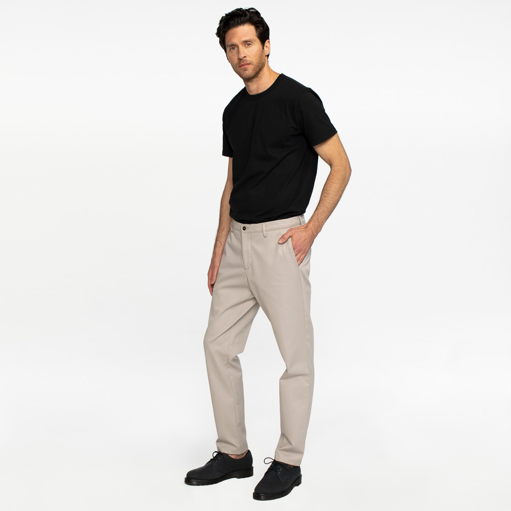 Model side facing wearing khaki chinos.