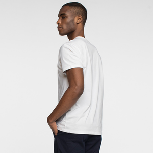 Model side facing wearing sustainable, performance white tee shirt.