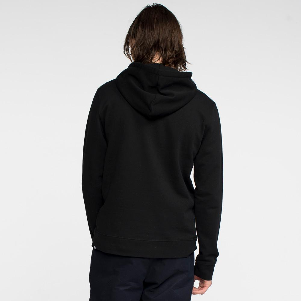 Model facing back wearing a black hooded sweatshirt.