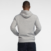 Model back facing wearing a heather grey, hooded sweatshirt.