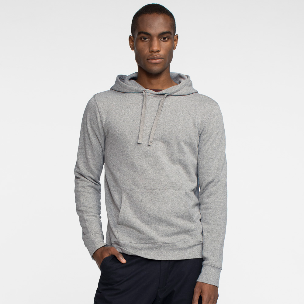 Model front facing wearing a heather grey hooded sweatshirt.