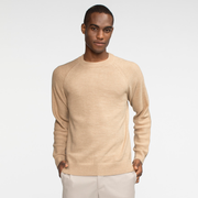 Model front facing wearing a natural colored alpaca raglan sleeve sweater.