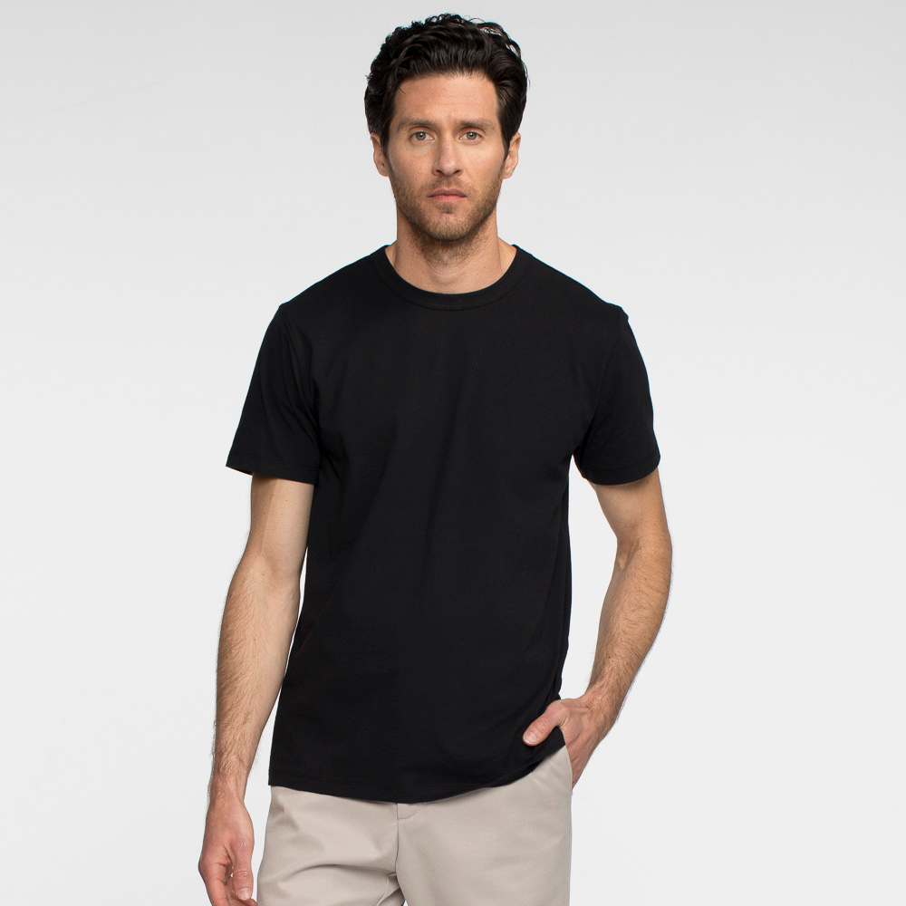 Model front facing wearing sustainable, performance black tee shirt.