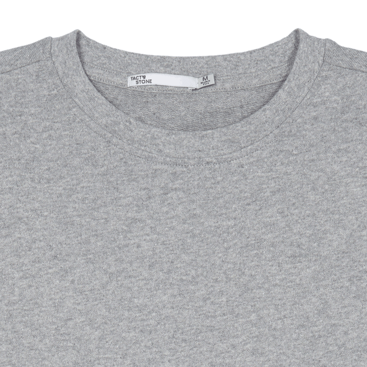 Zoomed in flat lay view of the collar and neck label of a crewneck, heather grey sweatshirt.