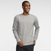 Model front facing wearing heather grey crew neck sweatshirt