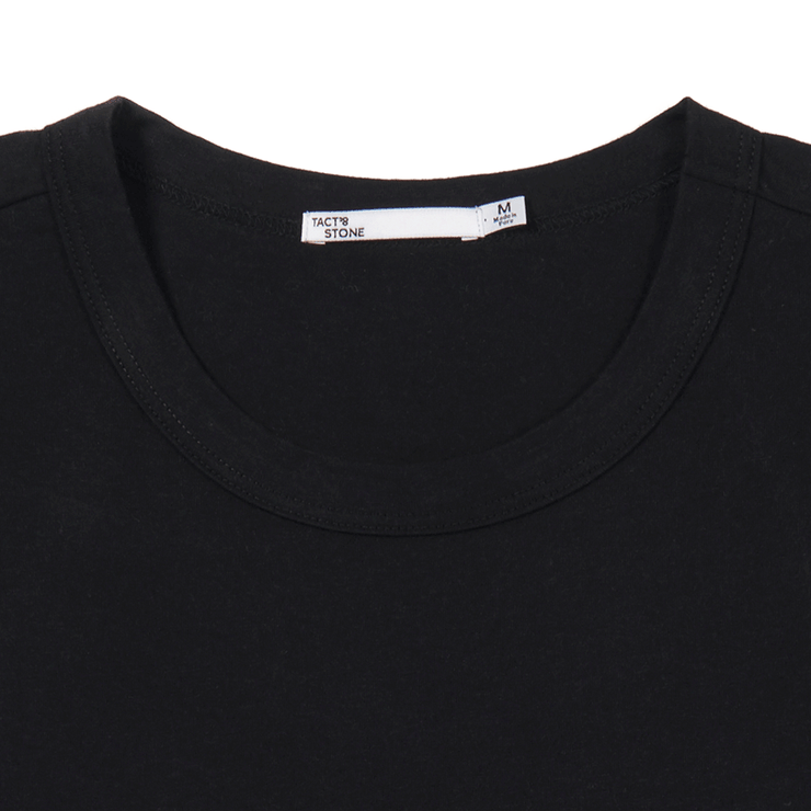 Zoomed in view of collar and neck label of black tee shirt. Made with organic cotton and recycled polyester.