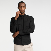 Model front facing wearing a long sleeve, black, oxford shirt.
