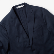 Front facing flat lay of navy blazer, zoomed to upper half of blazer.