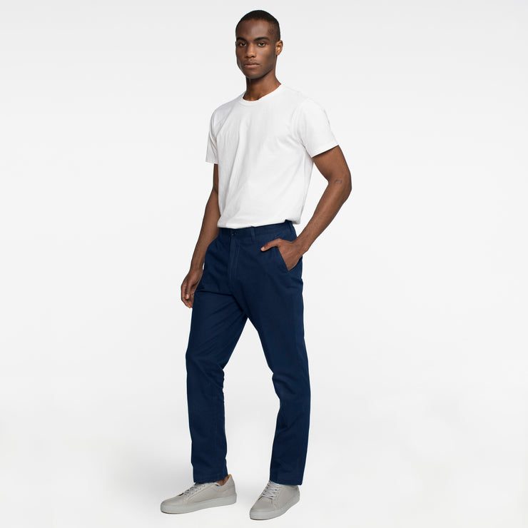 Model side facing wearing navy chinos.