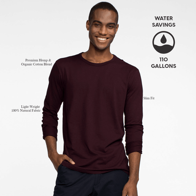 Model facing front wearing a long sleeve, burgundy tee shirt. Iconography explaining the sustainability benefits of the tee shirt.