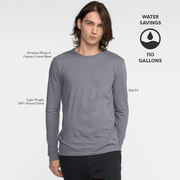 Model facing front wearing long sleeve, slate, tee shirt. Iconography explaining the sustainability benefits of the tee shirt.