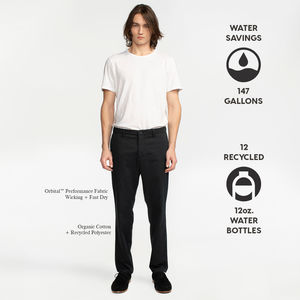 Model front facing highlighting black performance chinos. Iconography explaining the sustainability benefits of this product. Sustainable, performance chinos.