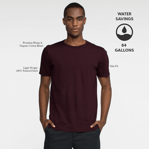 Model front facing wearing a short sleeve, burgundy tee shirt. Iconography explaining the sustainability benefits of the tee shirt.