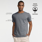 Model front facing wearing a slate, short sleeve tee shirt. Iconography explaining the sustainability benefits of the tee shirt.