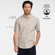 Model front facing wearing a short sleeve, heather grey, button up shirt. Iconography explaining the sustainability benefits of the shirt.