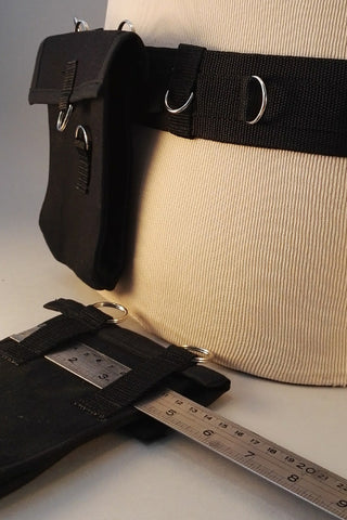 Utility belt with removable pouches
