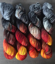 Load image into Gallery viewer, Eye of Sauron- Hand Dyed Superwash Merino Nomad Sock Fingering Yarn