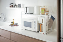 Load image into Gallery viewer, Yamazaki's white counter organizer sitting atop a microwave in a kitchen