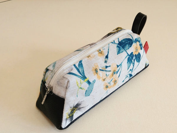 leather and fabric pencil or make-up case with flowers.