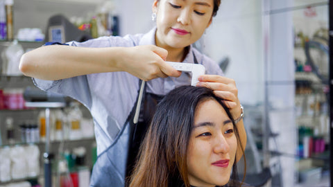 Stylist Assessing Hair Condition