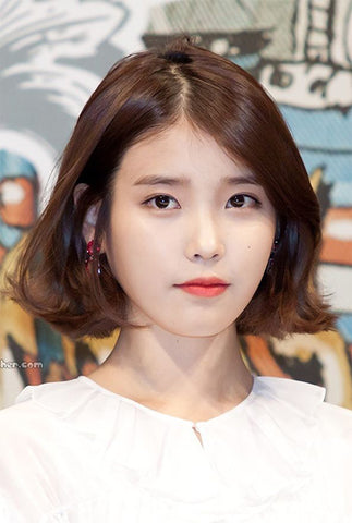 IU with her iconic short bob hair with fringe to the sides, as she prepares for Hotel Del Luna, Netflix's highly anticipated drama