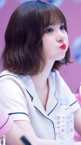 Eunha, lead vocal of Gfriend, kpop idol girl group who is well-known for her cutesy, doll-like look. Short, wavy bob looking doll-like as ever.