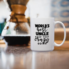 Load image into Gallery viewer, World's Best Uncle: Keep That Crazy Going – Mug by DieHard Java – Tea Mug 15oz – Ceramic Mug for Coffee, Tea, Hot Chocolate – Big Mug with Funny or Inspirational Captions – Top Quality Large Mug as Birthday, Christmas, Co-worker Gift