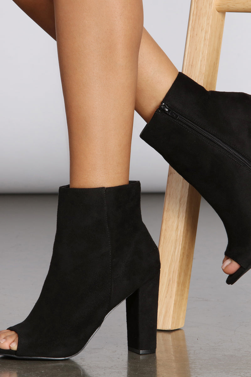 black ankle boots with high heel