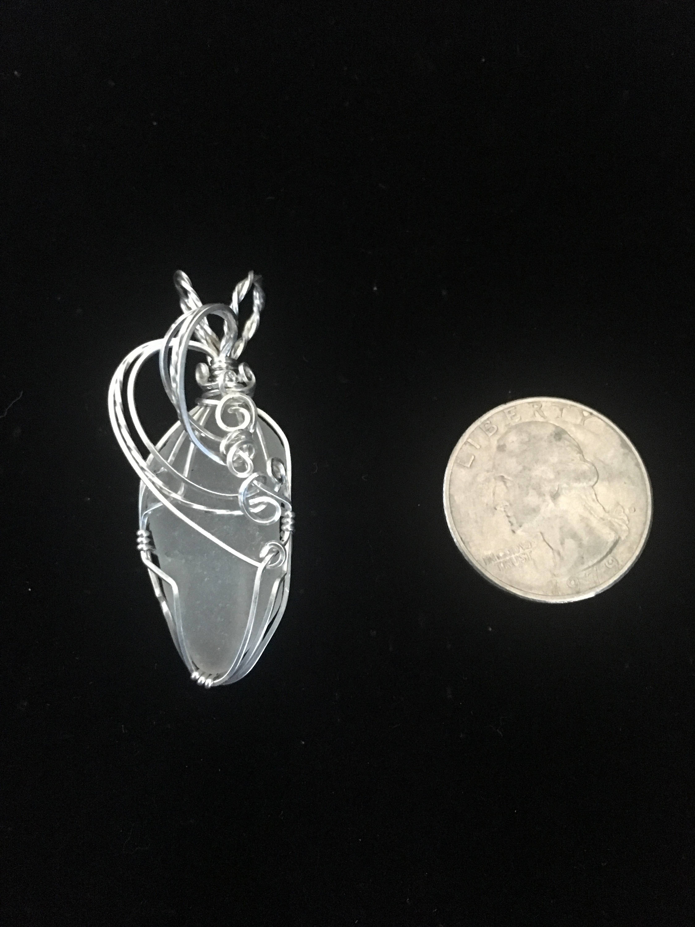Sterling silver wrapped sea glass pendant