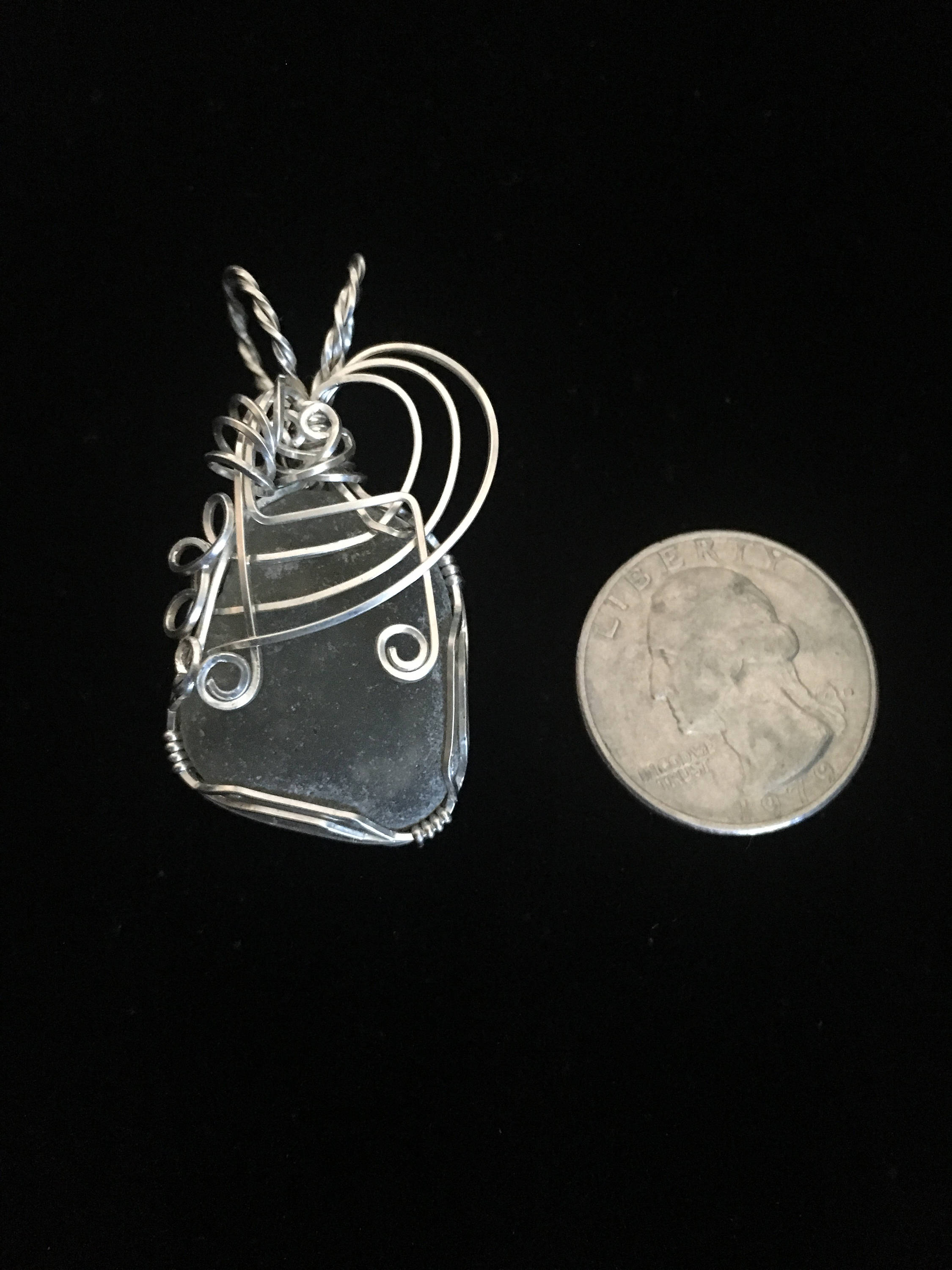 Sterling silver wrapped genuine sea glass pendant