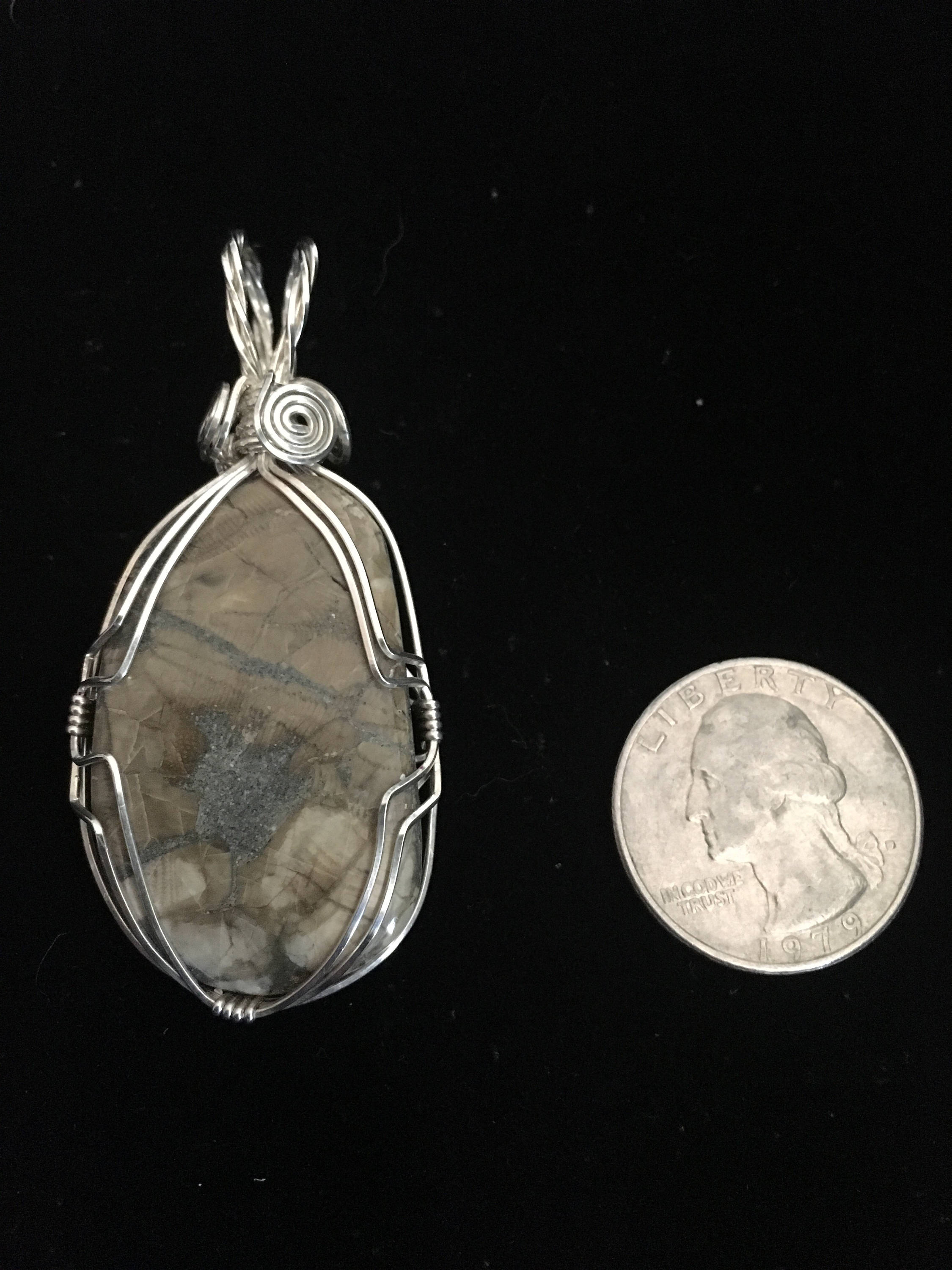 Sterling silver wrapped fossil pendant