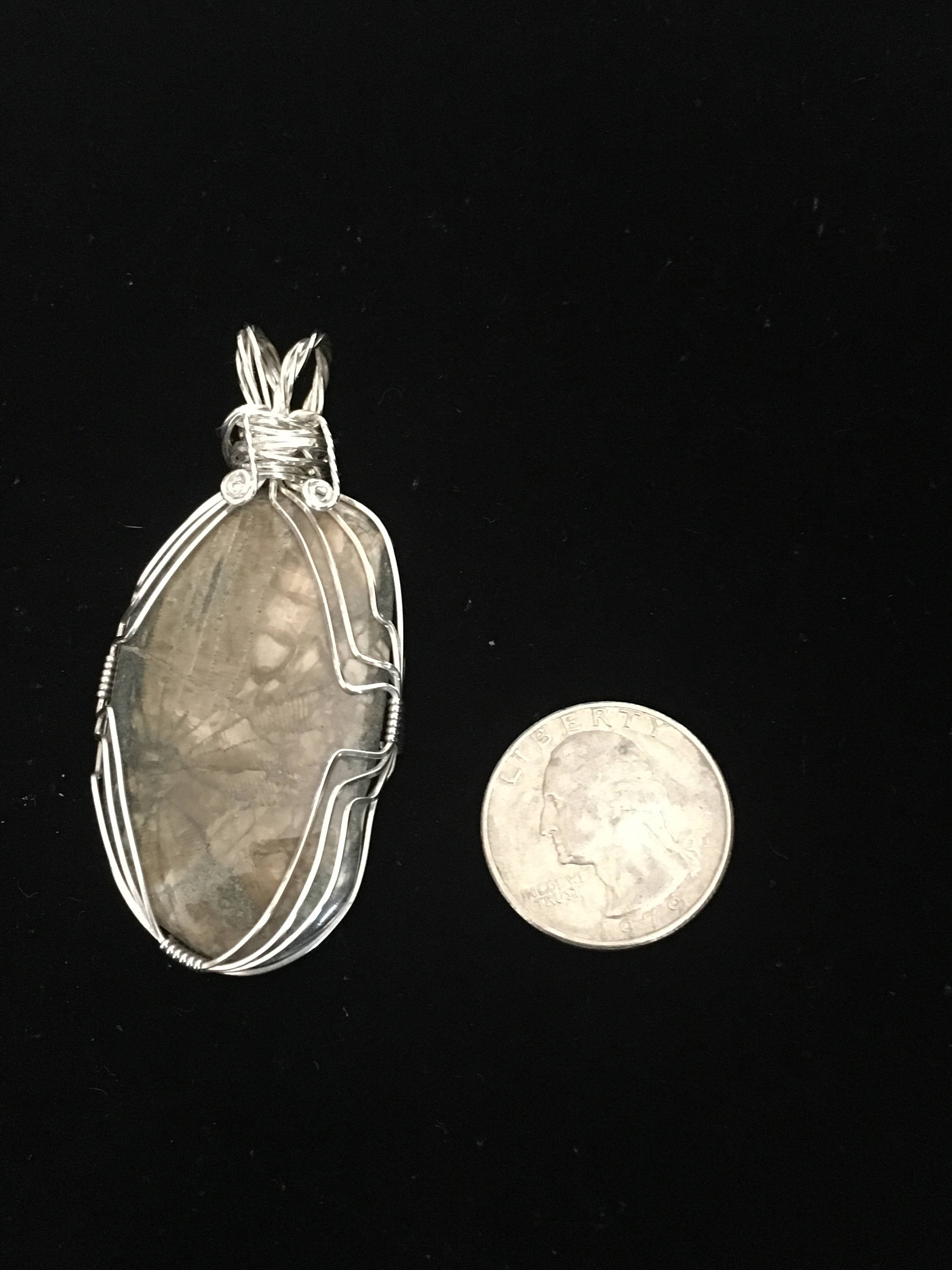 Large sterling silver wrapped hand polished sand dollar fossil pendant