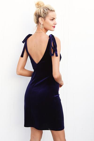 The Zoe Navy Blue Velvet Dress is perfect for special occasions like company events and holiday parties this season. The tie up straps add a little something extra! Shop now at Hello Lovely.