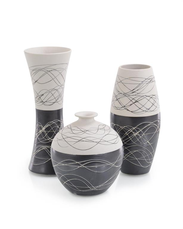 Set of Three Night-and-Day Porcelain Vases