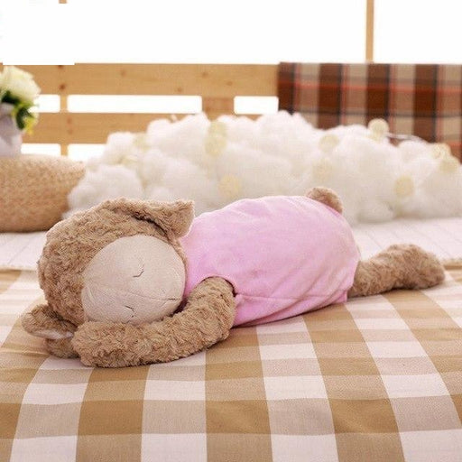 z. Plush Sleeping Lamb