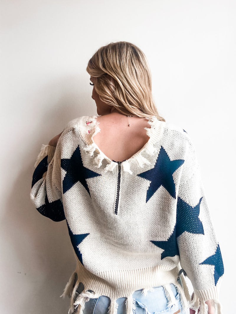 DISTRESSED CREAM BLACK STAR SWEATER