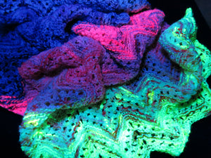uv reactive yarn glowing under black light