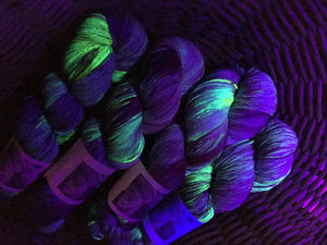 indie dyed uv reactive yarn under black light