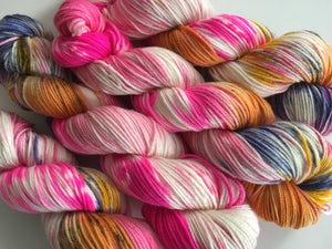 indie dyed uv reactive pink and orange DK yarn skein